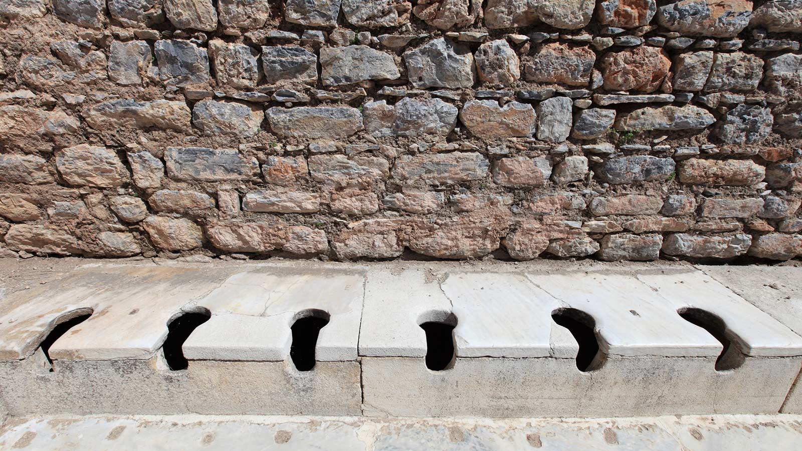 ancient toilet holes
